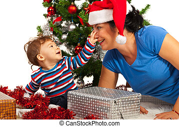 Funny mother with her baby at Christmas - Funny mother with...