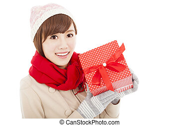 happy  young woman showing  gift box