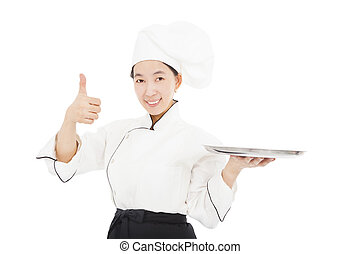 smiling young woman chef with thumb up