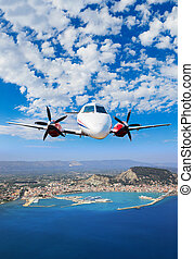 Aerial view on Zakynthos - Airplane flying over the island...