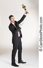 Business man - Successful business man is posing in studio