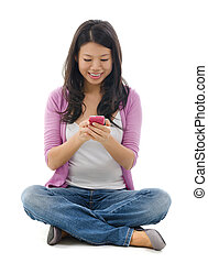 Young Woman texting on smart phone - Young Woman smiling and...