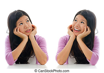 Sad and happy face expression of Asian woman, hands holding...