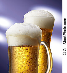 beers in mug and glass - two beers with foam in mug and...