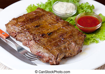 Grilled Steak - Grilled steak on a white plate