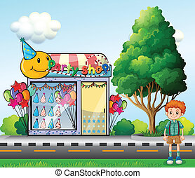 A curly young boy standing across the party shop
