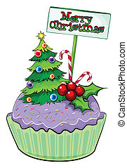 A cupcake with a christmas tree and a card