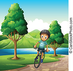 A male biker biking near the river - Illustration of a male...