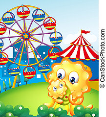 A yellow monster and her child at the carnival