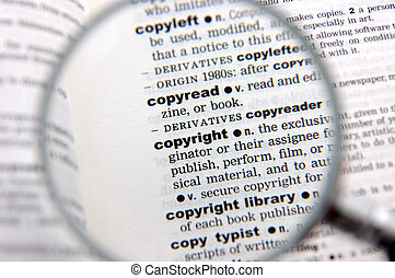 Definition of copyright emphasized by a magnifying glass