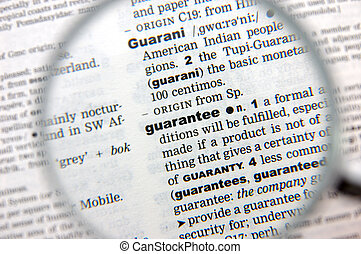 Definition of guarantee emphasized by a magnifying glass