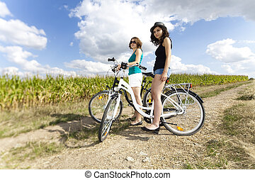 Young girls riding a bicycle
