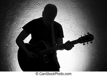 Guitar Player II - Guitar player on stage Silhouette Lighted...
