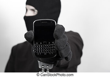 Thief with handcuff and phone - Thief pointing out his...