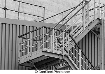 industrial stairs with stair railing wide by building