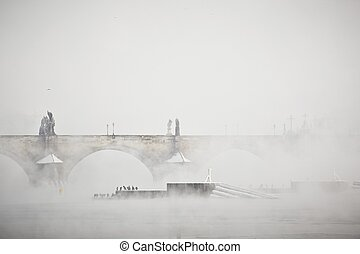 Frosty morning - Charles bridge in morning fog, Prague,...