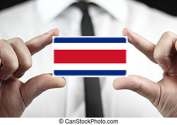 business card with Costa Rica Flag - Businessman holding a...