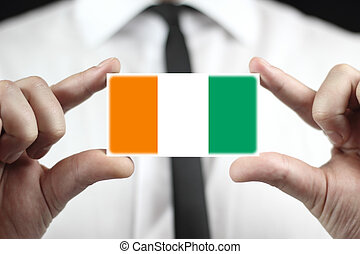 Ivory Coast Flag - Businessman holding a business card with...