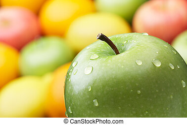 green apple and a group of colorful fruits