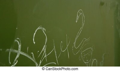 children draw on a chalk board
