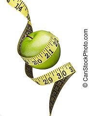 healthy eating - green apple and measuring tape on white...