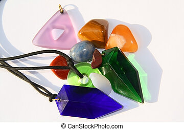 Stones and crystals on white - Various coloured crystals and...