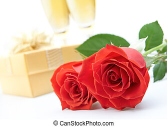 valentines day - roses, present and two glasses of champagne...