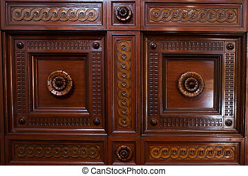 Ornate wooden paneling - Close up background of carved...