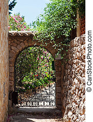 Wrought iron gate on the narrow street, Fornalutx, Majorca...