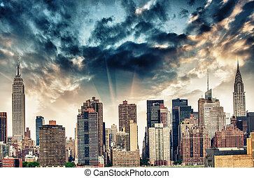 Manhattan midtown skyline panorama over East River with urban sk