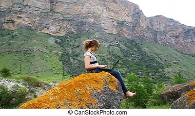 Young beautiful girl sitting on a h