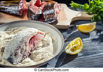 Closeup of fresh fish coated in flour