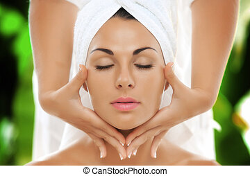 face - portrait of young beautiful woman in spa environment....