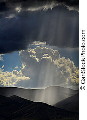 Rays of Sunlight on Peaceful Mountains - Sunlight rays from...