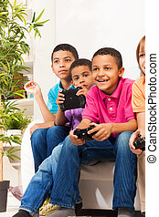 Gamers boys - Close portrait of a group of diversity looking...