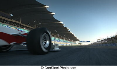 F1 racecar speeding past camera