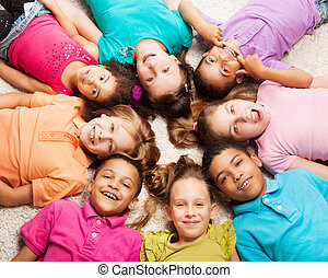Group of eight happy kids in star shape - Group of eight...
