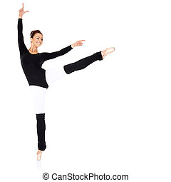 Graceful ballerina training in a black leotard and leggings...
