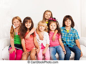 Smiling and hugging kids - Large group of kids hugging,...