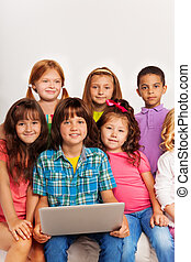 Close portrait of kids with laptop