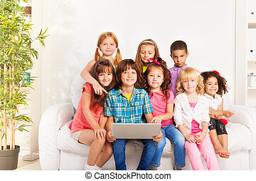 Happy group of kids with laptop