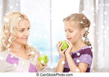 mother and daughter holding green apples - family, children,...