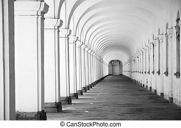 Long baroque arcade colonnade in black and white tone