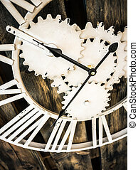 Clock on wooden wall processed in warm tone
