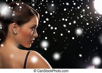 woman in evening dress wearing diamond earrings - luxury,...