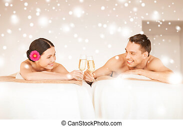 couple in spa - health and beauty, love, romance concept -...