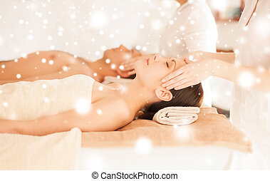couple in spa salon getting face treatment - health and...