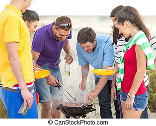 group of friends having picnic on the beach - summer,...