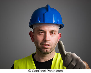 Worker expressing positivity with ok symbol. The worker is...