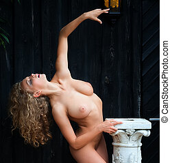 nude woman posing near the old country house - Beautiful...